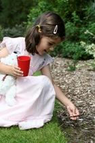 Girl planting at Birmingham Botanical Gardens